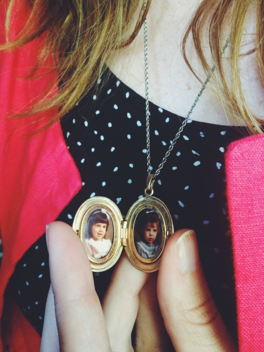 Raided grandma's jewelry box and found a locket with our pictures in it!